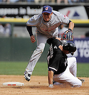 CHICAGO - APRIL 5:  Asdrubal Cabrera #13 of the Cleveland Indians avoids the sliding Paul Konerko #14 of the Chicago White Sox during the game on April 5, 2010 at U.S. Cellular Field in Chicago, Illinois.  The White Sox defeated the Indians 6-0.  (Photo by Ron Vesely)
