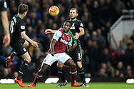 Michail Antonio of West Ham United blocks the ball from Erik Pieters of Stoke City. Barclays Premier league match, West Ham Utd v Stoke city at the Boleyn Ground, Upton Park  in London on Saturday 12th December 2015.<br /> pic by John Patrick Fletcher, Andrew Orchard sports photography.