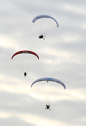 Paramotorist Sacha Dench (bottom) the 'Human Swan' arrives in Dover after crossing the Channel from France on her 3 month 7,000km trip following the migration route of BewickÕs swans from the Russian tundra to Gloucestershire.