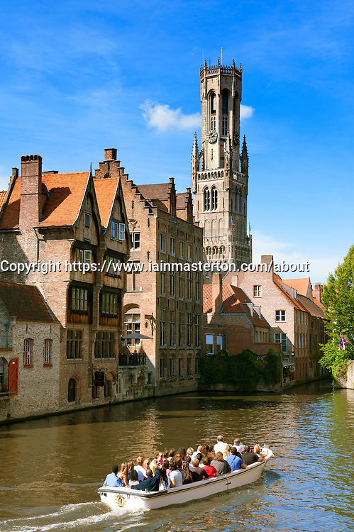 Famous Belfry and canal in Bruges Belgium