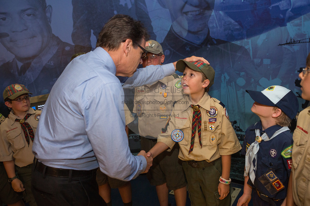 Former Texas Governor and GOP presidential hopeful Rick Perry greets a group of Boy Scouts before holding a town hall aboard the USS Yorktown in Mount Pleasant, South Carolina.