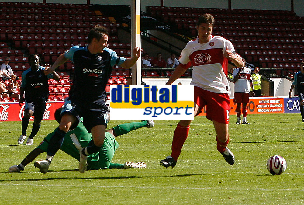 Photo: Steve Bond.<br />Walsall v Swansea City. Coca Cola League 1. 25/08/2007. Darryl Duffy (L) is foiled by Ian Roper (R). Clayton Ince is stranded