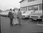 Tubberware Girls - New Cars 31/05/1976.05/31/1976.31st May 1976Pictured from left to right Michael Rowe, Managing Director Chrysler (Ireland) Limited, Louise Coleman, Tupperware Distributor and Hugh Crawford, Managing Director Crawford's Dun Laoghaire.