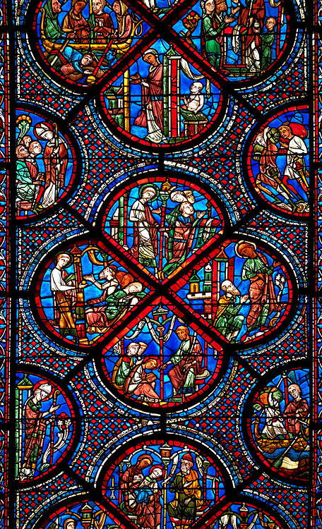 Medieval Windows  of the Gothic Cathedral of Chartres, France, dedicated to the life an miracles of St Nicholas. A UNESCO World Heritage Site. Centre panel,  bottom shows The young St Nicholas does well at school, left Nicholas secretly gives gold to an old man to save his daughters , right The old man tries to thank Nicholas, who humbly flees from him, top .Nicholas is chosen to be the new Bishop .