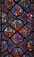 Medieval Windows  of the Gothic Cathedral of Chartres, France, dedicated to the life an miracles of St Nicholas. A UNESCO World Heritage Site. Centre panel,  bottom shows The young St Nicholas does well at school, left Nicholas secretly gives gold to an old man to save his daughters , right The old man tries to thank Nicholas, who humbly flees from him, top .Nicholas is chosen to be the new Bishop . .<br /> <br /> Visit our MEDIEVAL ART PHOTO COLLECTIONS for more   photos  to download or buy as prints https://funkystock.photoshelter.com/gallery-collection/Medieval-Middle-Ages-Art-Artefacts-Antiquities-Pictures-Images-of/C0000YpKXiAHnG2k