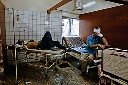 Two men are treated at the Al Kindy Hospital for injuries sustained while working at the UN base inside the Canal Hotel where a cement truck packed with explosives detonated outside the offices killing 20 people and devastating the facility in Baghdad, Iraq on Aug. 19, 2003. This was an unprecedented suicide attack against the world body with at least 100 people wounded.