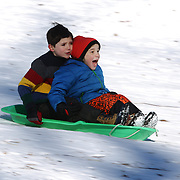 Young boys sledding in Central Park after New York City was hit with over 7 inches of snow during its first winter storm of the year. Central Park, Manhattan, New York, USA. 4th January 2014 Photo Tim Clayton