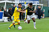 Andy Barcham (17) of AFC Wimbledon battles for possession with Ashley Smith-Brown (23) of Plymouth Argyle during the EFL Sky Bet League 1 match between Plymouth Argyle and AFC Wimbledon at Home Park, Plymouth, England on 6 October 2018.