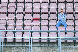 A Coventry City fan sits alone at the Sixfields Stadium  - Photo mandatory by-line: Dougie Allward/JMP - Tel: Mobile: 07966 386802 11/08/2013 - SPORT - FOOTBALL - Sixfields Stadium - Sixfields Stadium -  Coventry V Bristol City - Sky Bet League One