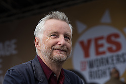 © Licensed to London News Pictures . 04/10/2015 . Manchester , UK . BILLY BRAGG at a demonstration against the Conservative government , organised by The People's Assembly , through Manchester City Centre , during the first day of the Conservative Party Conference in Manchester . Photo credit: Joel Goodman/LNP