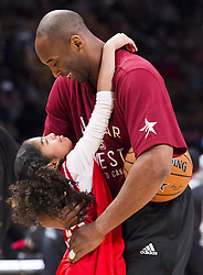 File photo dated february 14, 2016 of Los Angeles Lakers' Kobe Bryant (24) hugs his daughter Gianna on the court in warm-ups before first half NBA All-Star Game basketball action in Toronto, ON, Canada. Bryant, the 18-time NBA All-Star who won five championships and became one of the greatest basketball players of his generation during a 20-year career with the Los Angeles Lakers, died in a helicopter crash Sunday. Bryant's 13-year-old daughter Gianna also was killed. Photo by Mark Blinch/CP/ABACAPRESS.COM
