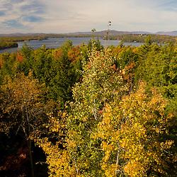 A view of fall foliage and Lake Winnepesauke from Abenaki Lookout Tower in Tuftonboro, New Hampshire.