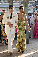 Travis Knowlton and Cassie Cathcart stroll the Weirs Beach Boardwalk prior to boarding the M/S Mount Washington for the Laconia High School Junior Prom Friday evening.  (Karen Bobotas/for the Laconia Daily Sun)