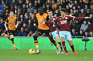 Hull City midfielder Mohammed Diame under attack from Burnley defender Matthew Lowton and Burnley midfielder Dean Marney during the Sky Bet Championship match between Hull City and Burnley at the KC Stadium, Kingston upon Hull, England on 26 December 2015. Photo by Ian Lyall.