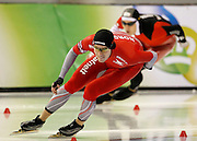 Mikael Flygind-Larsen of Norway, left, leads Canada's Denny Morrison as they compete in the men's 1500 meter World Cup speed skating competition at the Utah Olympic Oval in Kearns, Utah, Friday, Feb. 18, 2011. (AP Photo/Colin E Braley)