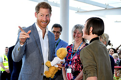 The Duke of Sussex is gifted a teddy bear by former patient Daisy Wingrove during a visit to Oxford Children's Hospital, based at the John Radcliffe hospital site in Oxford.