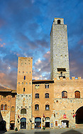 The Piazza Duomo (Cathedral Square) of San Gimignano with its medieval towers built as defensive towers and also to show the families wealth by the height of the tower. A UNESCO World Heritage Site. San Gimignano; Tuscany Italy <br /> <br /> Visit our ITALY PHOTO COLLECTION for more   photos of Italy to download or buy as prints https://funkystock.photoshelter.com/gallery-collection/2b-Pictures-Images-of-Italy-Photos-of-Italian-Historic-Landmark-Sites/C0000qxA2zGFjd_k<br /> If you prefer to buy from our ALAMY PHOTO LIBRARY  Collection visit : https://www.alamy.com/portfolio/paul-williams-funkystock/sangimignano.html