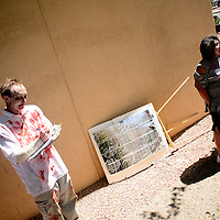 052513  Adron Gardner/Independent<br /> <br /> Tyson Whittaker, left, calls up contestant Shelby Zunie in the zombie makeup contest  at the Octavia Fellin Library in Gallup Saturday.