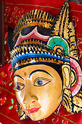 Beautiful painted face or mask of an Indonesian woman at vendors booth. Dragon Festival Lake Phalen Park St Paul Minnesota USA