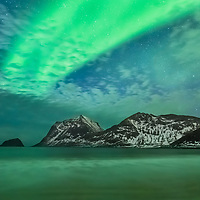 Far within the arctic circle, an otherworldly wave of magic fills the night sky in the Lofoten Islands of northern Norway.