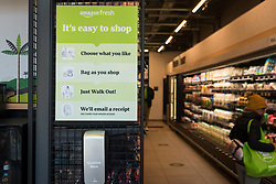 "© Licensed to London News Pictures. 07/03/2021. LONDON, UK.  A customer shops in the new 2,500 sq ft Amazon Fresh store in Ealing, west London on its first weekend of opening. It is the first ""just walk out"" grocery store in the UK and the first outside the USA.  As a ""contactless"" shop, it is available to anyone signed up to Amazon and with the app on their smartphone.  In-store cameras and artificial intelligence monitor customers picking up items who simply walk out and billing takes place later automatically.  Photo credit: Stephen Chung/LNP"