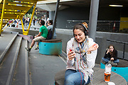 Young woman smiles while she enjoys a Facetime call with a friend on her smartphone. She is happily in her own world, smiling and laughing and making faces towards her iPhone. A positive side to mobile phone technology. The South Bank is a significant arts and entertainment district, and home to an endless list of activities for Londoners, visitors and tourists alike.