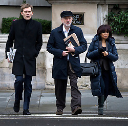 © Licensed to London News Pictures. 17/01/2016. London, UK. Labour party leader JEREMY CORBYN arriving at BBC Broadcasting House with his adviser SEUMAS MILNE (left) and wife LAURA ALVAREZ (right) to appear on The Andrew Marr Show on BBC One. Photo credit: Ben Cawthra/LNP