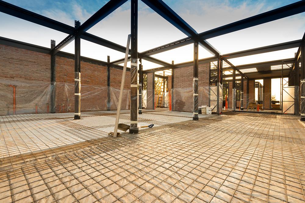 Steel bar framework preparation for a concrete slab.