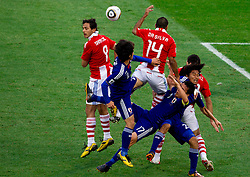 Roque Santa Cruz and Paulo Da Silva of Paraguay vs Yuki Abe and  Makoto Hasebe of Japan during the 2010 FIFA World Cup South Africa Round of Sixteen football match between Paraguay and Japan on June 29, 2010 at Loftus Versfeld Stadium in Tshwane/Pretoria. (Photo by Vid Ponikvar / Sportida)