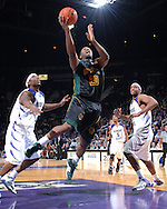 Baylor forward Tim Bush (20) drives the lane in the first half past Kansas State defenders Luis Colon (R) and David Hoskins (L) for the score at Bramlage Coliseum in Manhattan, Kansas, January 17, 2007.  The Wildcats and Bears are tied at halftime 39-39.