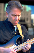 Musician age 35 wholeheartedly playing guitar. Exchange Charities Youth Festival Minneapolis  Minnesota USA