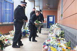 ©Licensed to London News Pictures 26/09/2020  <br /> Croydon, UK. An armed police officer laying flowers   for Sgt Matt Ratana at Croydon Custody Centre. A murder investigation has been launched by police after the death of  custody police sergeant Matt Ratana at the Croydon Custody Centre in South London yesterday.Photo credit:Grant Falvey/LNP