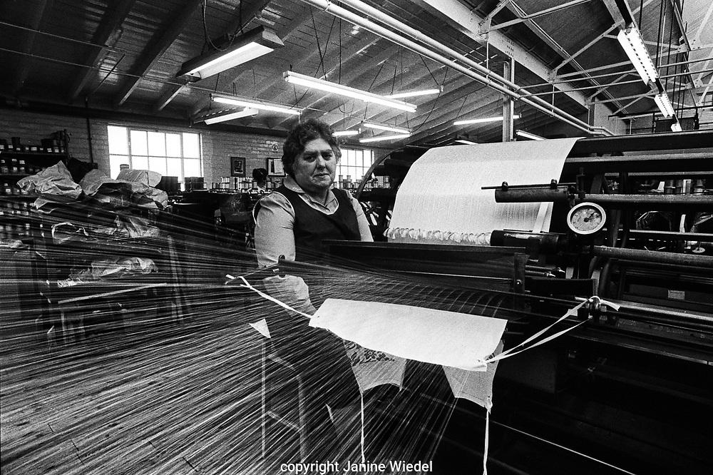 Female weaver in Gainsborough Silk Weaving Mill in Sudbury East Suffolk 1980s