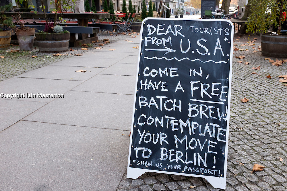 Sign outside cafe in Berlin offering free coffee to Americans after Trump victory in US Presidential election 2016
