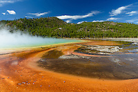 The Grand Prismatic Spring is 370 feet around making it the biggest hot spring in the US. The microbial mats give the spring it's intense colors.
