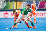 Ireland's Shane O'Donoghue is tackled by Thierry Brinkman of The Netherlands. Ireland v The Netherlands - Semi-Final Unibet EuroHockey Championships, Lee Valley Hockey & Tennis Centre, London, UK on 27 August 2015. Photo: Simon Parker