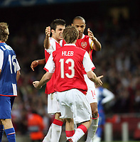 Photo: Chris Ratcliffe.<br /> Arsenal v FC Porto. UEFA Champions League, Group G. 26/09/2006.<br /> Alexander Hleb of Arsenal celebrates scoring the second goal with Thierry Henry and Cesc Fabregas.