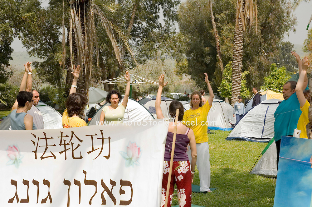 Israel, Galilee, Falun Gong AKA Falun Dafa meditation session. This is also used to protest against the Chinese government prosecution of the followers of this method in China
