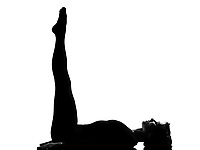 woman yoga Upward Extended Feet Pose - urdhva prasarita padasana exercising lying on back fitness yoga stretching  in shadow grayscale silhouette full length in studio isolated white background