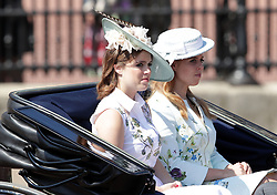 Princess Eugenie of York (left) and Princess Beatrice of York make their way down The Mall from Buckingham Palace, central London to Horse Guards Parade for the Trooping the Colour ceremony as the Queen celebrates her official birthday today.