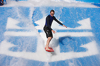 Royal Caribbean International's  Independence of the Seas, the world's largest cruise ship...A surfer on the Flowrider *** Local Caption *** A surfer on the Flowrider