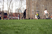 guys playing soccer in a public park Brooklyn NY