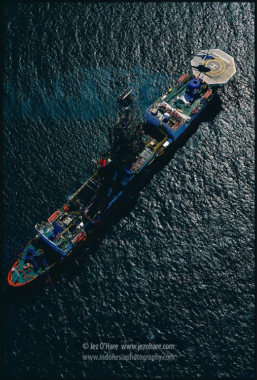 'Deep Sea Ice' drill ship, Bintuni Bay, West Papua, Indonesia. May 1998. <br /><br />http://www.energyglobalnews.com/aban-ice-oldest-drillship-operation/