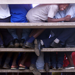 PIC BY PAUL GROVER IN THE MBIZO STADIUM IN THE TOWN OF KWEKWE IN THE MIDLANDS AREA OF ZIMBABWE PIC SHOWS SCHOOL BOYS DURING THE SPEECH AT A ZANU PF ELECTION RALLY PIC PAUL GROVER