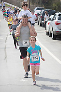Kauneonga Lake, New York - Kaitlyn Morse (323), 7, and Joseph Colaianni (34), with his son Andrew, 6, of Washingtonville run the Allyson Whitney 5K Walk/Run on May 10, 2014. The Allyson Whitney Foundation is a public charity organization that empowers and fights for the interests of young adults with rare cancers.