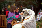 Kids age 10 playing with ghoul at Halloween time.  St Paul Minnesota USA