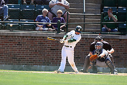 14 April 2013:  Zach Scott bats, Zach Tsiodras catches, Steve Jones umpires during an NCAA division 3 College Conference of Illinois and Wisconsin (CCIW) Baseball game between the Elmhurst Bluejays and the Illinois Wesleyan Titans in Jack Horenberger Stadium, Bloomington IL