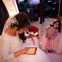 Rahel Berdugo prays a few minutes before the begining of her wedding ceremony in Jerusalem.