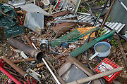 Household objects scrap metal await recycling on rural land, on 30th July 2017, in Wrington, North Somerset, England.
