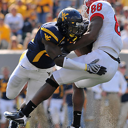 Oct 4, 2008; Morgantown, West Virginia, United States; Rutgers wide receiver Kenny Britt (88) is tackled after making a catch by West Virginia defensive back Ellis Lankster (2) during the fourth quarter of Rutgers 24-17 loss to West Virginia at Milan Puskar Stadium.